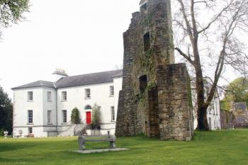 Castlecoote House, an historic Georgian mansion in Co. Roscommon, is open for B&B from April 1 until the end of September. In the foreground is a 16th Century castle tower. 	Judy Enright photos