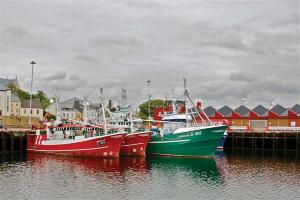 Fishing boats docked in colorful Killybegs Harbor in Co. Donegal.