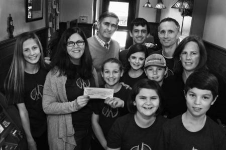 Members of the Youth Board of Directors of the Martin Richard Foundation gratefully acknowledge a $1,000 check donated to the foundation by Dermot and Cindy Quinn of Greenhills Irish Bakery. The Youth Board's next project will be producing Easter baskets for homeless kids in Dorchester. Front row, from left: Jane Richard and Peter Datish. Middle: Annie Jackson, Denise Richard, Ava O'Brien,  Liley Damatin, Jack Burke, Cindy Quinn. Back: Dermot Quinn, Henry Richard, Bill Richard.