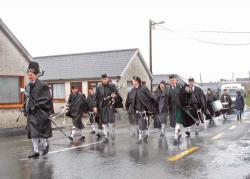On Achill Island in Co. Mayo, members of a traditional pipe band braved rain and wind to carry out the annual parade on St. Patrick's Day.