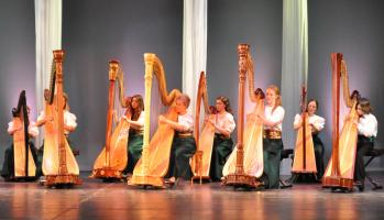 "The Massachusetts Harp Ensemble, led by Judy Ross, performs in ""A Little Bit Of Ireland.""  	Reagle Music Theatre / Herb Philpott photo"