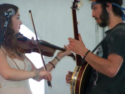 Kathleen Parks and Ricky Mier of the band Cat and the Moon share a duet during the Boston Irish Festival music weekend. 	Sean Smith photo