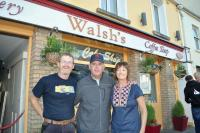 Marty Walsh joins Joan and Cathal Walsh (no relation) outside the shop in the centre of Clifden in Connemara, Co. Galway. Photos by Bill Forry