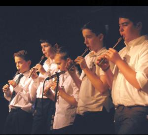 Tin whistle players performed a medley as part of the Trad Youth Exchange concert.