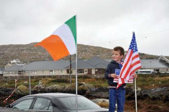 Michael Ó Cathasaigh, age 5, of Dubhithir, Carna, County Galway awaits the arrival of Mayor Walsh in Carna on Tuesday, Sept. 23.