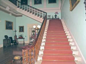 The elegant entrance hall, adorned with Perceval family portraits, at Temple House in Ballymote, Co. Sligo. Temple House is one of 36 select and historic private homes in Hidden Ireland (hiddenireland.com), a group that welcome guests for a unique and extraordinary B&B experience. (Judy Enright photos)